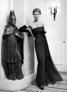 19-12-11  Stella in chestnut mousseline empire-style evening gown with black satin ribbon streamer by Jacques Fath, photo by Jacques Rouchon, 1953