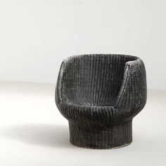 This unique accent chair combines mid-century modern form with a traditional rattan composition.