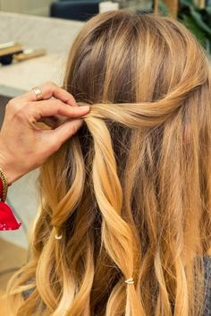 A true hair miracle is when you find (and master) a style that's simultaneously easy to do, can be done in under 5 minutes with minimal tools required, and