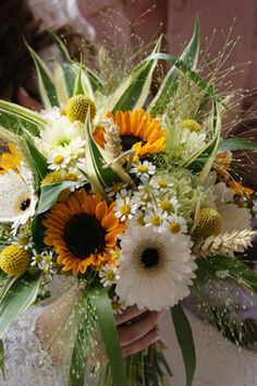Sunflower wedding bouquet. Hand tied Wedding bouquet in autumn style. Including Helianthus, Germini and Tanacetum daisies. from £65. www.hollyhocks-shop.co.uk