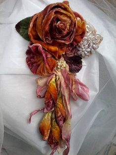 Lovely large tattered shabby Brooch/corsage/hair accessory, featuring a hand created silk velvet rose, hand dyed in variegated in autumn tones, and olive green Surrounding the main bloom are a gathered velvet bloom with a pearl centre, velvet leaf, hand made velvet rose buds on