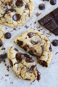 Choc lovers CCC- 3 1/4 cups all-purpose flour,  1 1/2 teaspoons baking powder,  1 teaspoon baking soda,  1 teaspoon sea salt,  1 cup unsalted Butter, at room temperature,  1 1/2 cups light brown sugar,  1/2 cup granulated sugar,  2 large eggs,  2 teaspoons vanilla extract,  1 1/2 cups chocolate chunks,  1 1/2 cups chocolate chips,  1/3 cup grated chocolate,  Extra sea salt for sprinkling on cookies, if desired