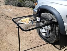 Tailgater Tire Table, Mount it to the spare or one of the 4 tires with the simple tool-free mounting system Camping Table, Truck Camping, Tent Camping, Camping Gear, Camping Hacks, Outdoor Camping, Tailgate Tent, Tailgating, Vw T5