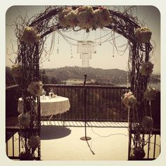 Posh Peony Vintage shabby chic ceremony arch with curly willow, pearls, and crystals.