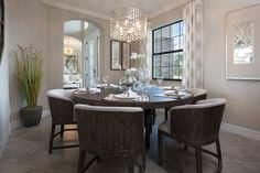 Would you stand up and cheer if you had this dining room and CHANDELIER?! #florida #newhome #diningroom #chandelier #decor #style #realestate