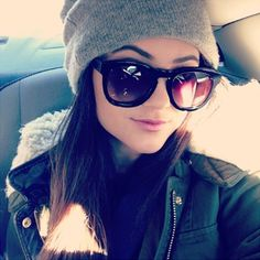 kylie jenner pulls off winter so well in big sunglasses, fur jacket and grey bini <3