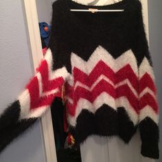 NWOT! XL oversized fuzzy sweater, soft as a cloud! Takara NWOT oversized softest sweater ever!!! Black, red, and off white size XL, purchased at Dillards and by the time I got around to wearing it, it was just to big on me. I'm a large now, sometimes a medium. I bought my daughter one just like it for Christmas last year and she loved it! The feel is like those fuzzy aloe soft socks! Takara Sweaters