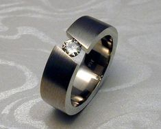 Tension set diamond band, with diagonal opening. Tension set diamond, with diagonal opening set in wide comfort fit band. Brushed surface on outside of band. Custom Made Engagement Rings, Contemporary Engagement Rings, Engagement Bands, Wedding Ring Bands, Wedding Knot, Wedding Engagement, Fall Wedding, Wedding Ideas, Men's Jewelry Rings