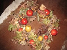 the perfect fall wreath to take you from now through the end of November. Fruits, nuts, berries, leaves.