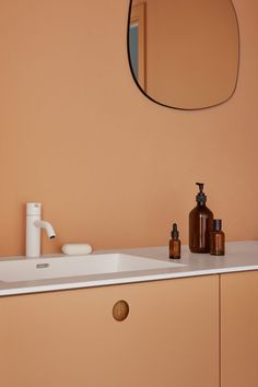 Reform has also created a nude-tone bathroom. Visible from the main workspace through a framed doorway, it sits in bold contrast to the showroom's otherwise all-white surfaces.