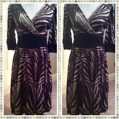 DRESS SALE Like the other two dresses in this style, this dress is more of a true lightweight knit dress. Not the same fabric as the others.  Same V neck style, with side zipper and self tie belt in the back.  A beautiful flowy full skirt to twirl..our colors of Grey and Black make this dress look more like a Zebra Style  Sizes available are S(2-4) M (6-8) and L (10-12). Aryeh Dresses