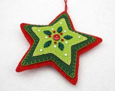 Red and green felt star Christmas ornament. Handmade felt hanging star with embroidered leaves and berries in greens and red, and a red button. A perfect gift or decoration .Scandinavian heart Christmas Ornament handmade by PuffinPatchworkShop for on Felt Christmas Decorations, Felt Christmas Ornaments, Glitter Ornaments, Beaded Ornaments, Easy Felt Crafts, Xmas Crafts, Handmade Felt, Handmade Ornaments, Ornaments Ideas