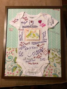 Good baby shower guest gifts baby shower gift guests sign onesie onesie guest sign in that i made for my cousins baby shower background is wrapping paper and the pieces of cloth are samples from her baby bedding solutioingenieria Image collections