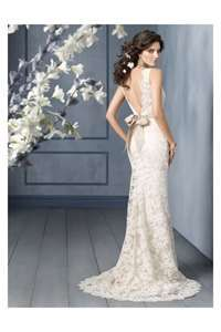 This deep cut lace wedding dress is absolutely gorgeous! So feminine & chic. #weddingdress