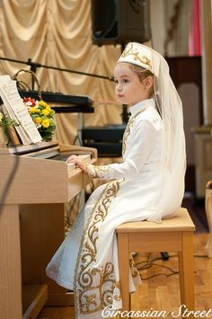 A Circassian child playing piano