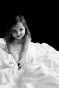 Photograph your little girl in your wedding dress & give it to her on her wedding day. Beautiful.