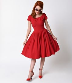 Once you slip into this bewitching beauty, youll never want to take it off! The rich red Lucy dress, from House of Foxy, is comfortably elegant…