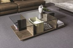 Contemporary Design | Wooden Coffee table design with a delicate glass top, creating several storage or decorative divisions | #coffeetables modern design #livingroomdesign the living room #moderncoffeetables living room coffee tables | Visit our blog www.coffeeandsidetables.com