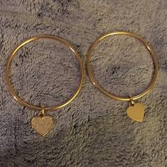 """NEW Michael Kors Bangle Bracelet Set of Two New never worn without box (unfortunately lost while moving, they have been stored in my jewlery box) Michael Kors set of two bangle bracelets. Gold colored. One has a plain heart on both sides, and the other has """"xoxo Michael Kors"""" on one side, and flips over to the """"diamond, sparkly"""" side. Price is firm unless bundled. Michael Kors Jewelry Bracelets"""