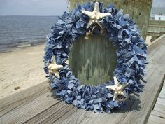 Denim rag wreath with shells. - Maybe make plain and attach red bandanna and white star for summer / July 4th door decoration