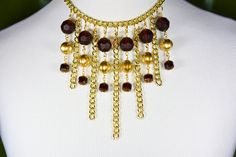 You'll steal the show in this dramatic adjustable gold-tone chain necklace adorned with gold Czech glass melon beads and Czech cathedral glass in garnet. $25 at #SmallestPlanet on #Etsy. Get 15% off your entire purchase with coupon code PIN15.