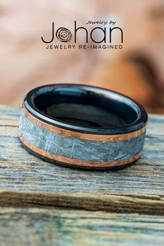 Copper pinstripes surround an inlay of Gibeon meteorite in this black ceramic wedding band from Jewelry by Johan. #JewelrybyJohan