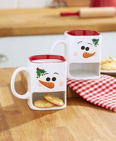 Enjoy the classic cookies and milk combo with this Set of 2 Snowmen Cookie Mugs…