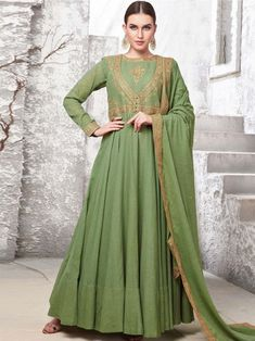 Superior green maslin cotton gown online which is crafted from maslin cotton fabric with exclusive hand work also comes with cotton crepe bottom, maslin cotton dupatta. Cotton Anarkali, Anarkali Gown, Lehenga, Anarkali Suits, Silk Dupatta, Sharara Suit, Designer Wedding Gowns, Designer Gowns, Designer Anarkali