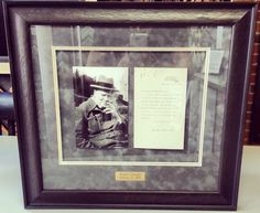 Ways to display heirlooms: This is a typed letter signed by Winston Churchill with suede triple suede matting, photograph and nameplate by Major League Sports Engraving, Trophies & Plaques. Custom framed by FastFrame of LoDo.
