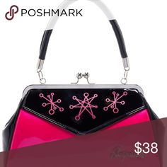 SOURPUSS SPUTNIK BACKSEAT BABY PURSE The Backseat Baby Purse has gone atomic with a pink, retro satellite print!! This classic Sourpuss handbag features a sturdy, vintage shape, satin lining, kiss-lock closure and easy grip handles. Great arm candy for car shows, the bowling alley (though don't expect to find any rental shoes to match) or a night out on the town! Sourpuss Bags Satchels