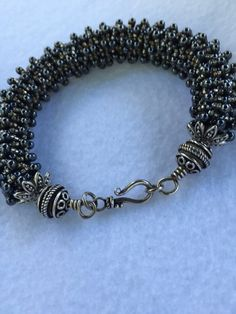 Black and Silver Caterpillar Bracelet by StoneSupport on Etsy