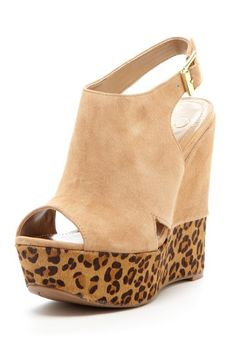 """Jessica Simpson  Claye Wedge    Step into chic wedge sandals that will ultimately take your style to the next level.  - Peep toe  - Covered vamp with side vents  - Slingback strap with buckle side closure  - Approx. 5.5"""" heel, 1.75"""" platform  - Imported"""
