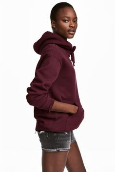 Wide top in sweatshirt fabric with a lined drawstring hood, kangaroo pocket and ribbing at the cuffs and hem. Cut Sweatshirts, H&m Online, Pantone Color, Fashion Online, Hoods, Kids Fashion, Turtle Neck, My Style, Sweaters