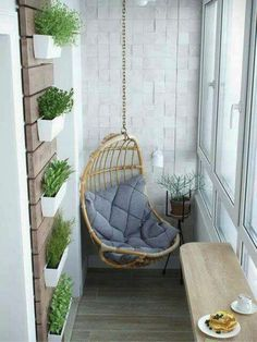 A vertical garden and a cane swing is all you need to turn the little balcony space into a chic relaxing corner Image Credit: keltainentalorannalla.blogspot.hu