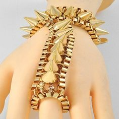 """Gold Spike Chain Link #Bracelet/ #Ring. Bring out the fashionista side of you! This gold 7.5"""" L spike chain link bracelet and ring combo is stretchable and will adjust to fit. Details: http://www.lolafashionaccessories.com/products/Gold-Spike-Chain-Link-Bracelet%7B47%7DRing--.html $21.99"""