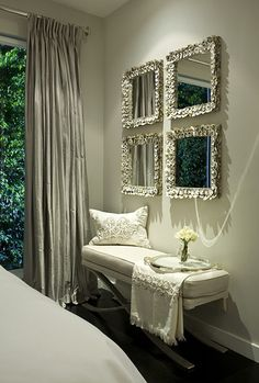 Four mirrors over a bench / small sofa. Colour scheme.