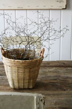 Basket with twigs on a weathered table