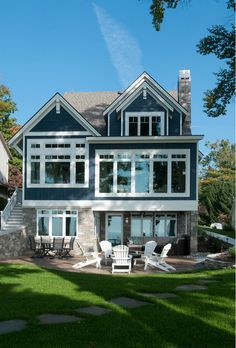 Designed by Wayne Visbeen and meticulously built by Mike Schaap Builders,this lakefront cottage features inspiring coastal interiors and...