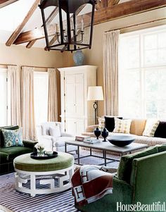 This family room uses scale and symmetry in a high-ceilinged space. Design: Patricia Healing and Daniel Barsanti