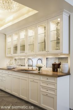 The butler's pantry in our NY showroom shows off the original SieMatic BeauxArts style in Magnolia White high-gloss lacquer.
