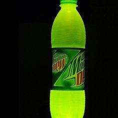 """*่DIY: glowing soda- first empty get a bottle of Mountain Dew and pour it put until there is about 1/4 of it left. Next, add a pinch of baking soda and three capfuls of hydrogen peroxide. Shake it and it glows!! You can even pour it on the sidewalk for glowing """"paint"""" -"""