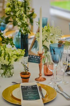 Gold, rose gold and blue wedding decor and floral set up