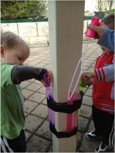 Bubble mix doesn't last long in the hands of a child... Create a bubble station to provide a solution. Genius!!!