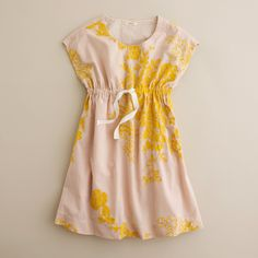 Just like the one we made for Mom—only smaller. A simple shift silhouette made extra special with exquisite floral embroidery. Beautifully styled in crisp cotton with hand-draped tucks and a drawstring waist that gathers the sides. Sleeveless. Straight skirt. Elastic waistband with drawstring. Side-seam pockets. Fully lined. Falls to knee. Import. Hand wash.