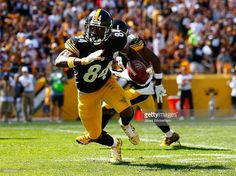 Antonio Brown #84 of the Pittsburgh Steelers runs with the ball following a 59 yard pass in the first quarter against the San Francisco 49ers during the game at Heinz Field on September 20, 2015 in Pittsburgh, Pennsylvania.
