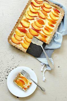 Homemade peach custard tart with vanilla pastry cream