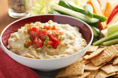 hot and cheesy artichoke dip.  suggested to add chilies instead of garlic.  no tomato/onion topping.  brown, serve with sliced baguettes