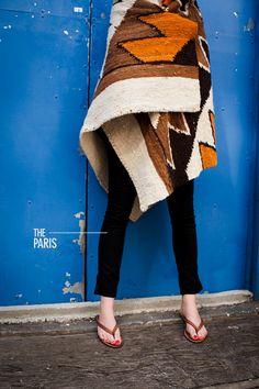 We're crazy for these colors! Plus, ponchos, serapes, and capes are definitely HOT STYLE right now! This blanket looks amazing wrapped around those black skinny jeans! Cool!