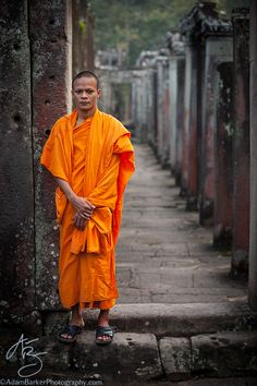 A monk kindly poses for a portrait at the Bayon, Angkor Thom, Cambodia