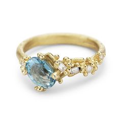 Ruth Tomlinson asymmetric yellow gold ring with blue topaz and white diamonds, handmade in London